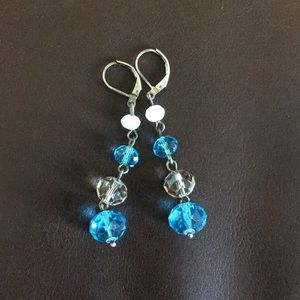 Blue and white dangly earring never worn